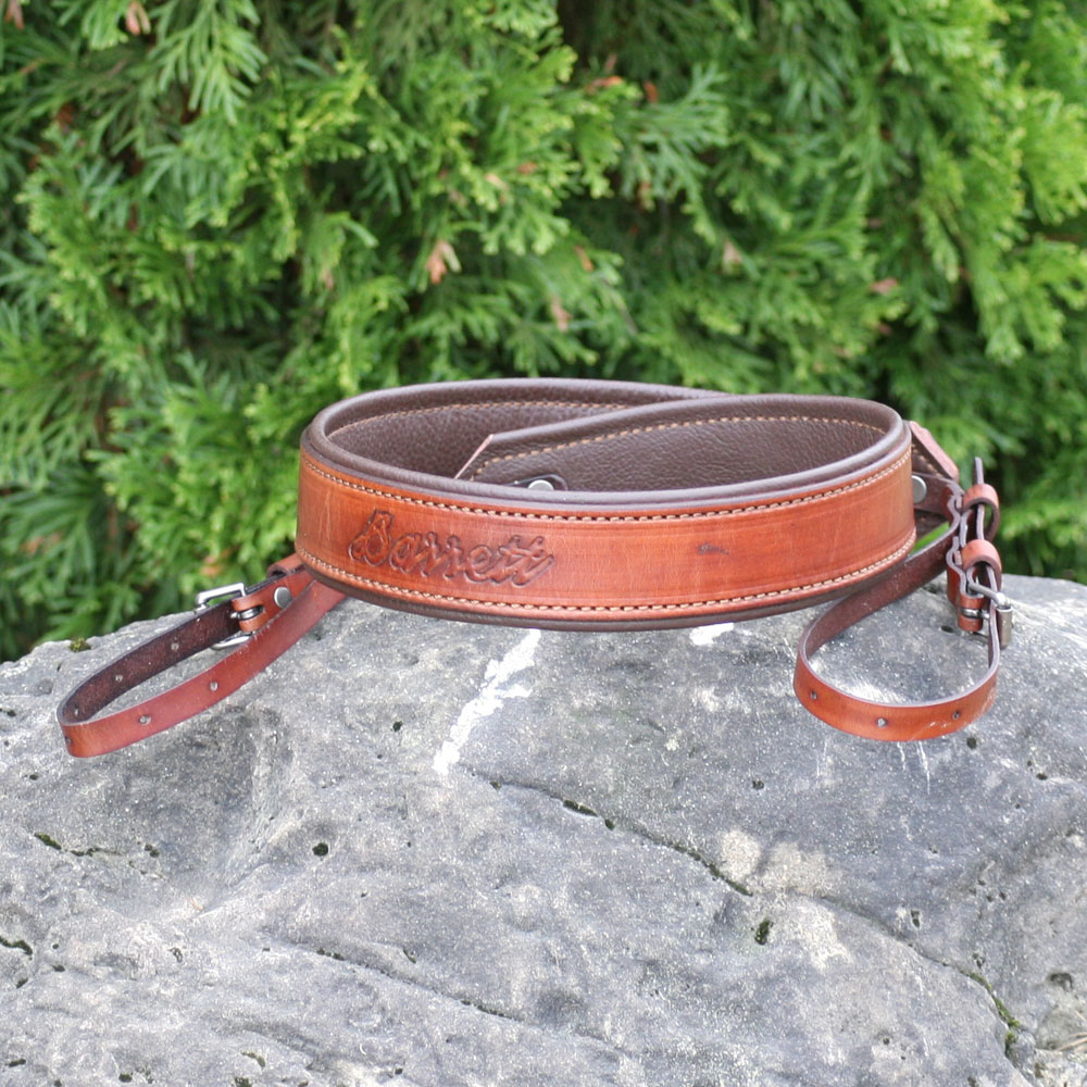 camera sling embossed with the customers name
