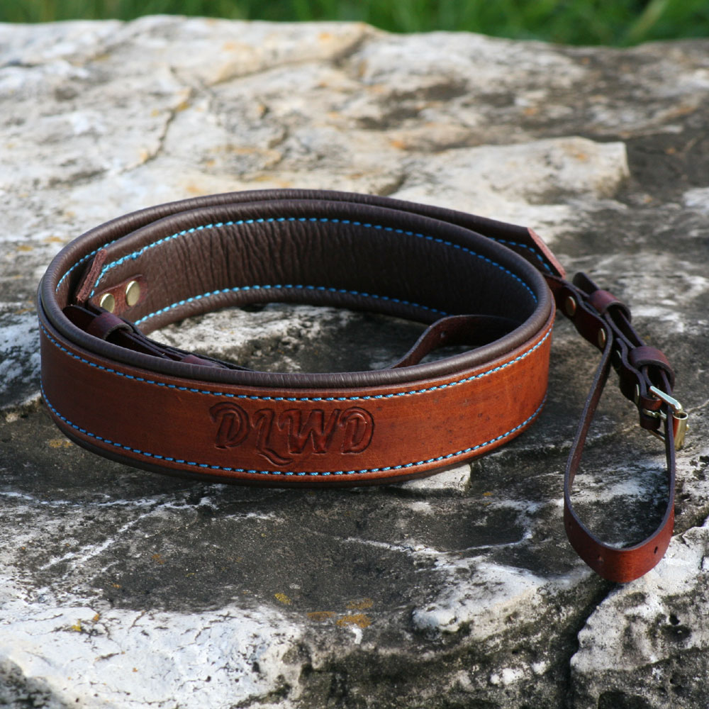 Medium brown with brown padding, turquoise thread and polished brass hardware