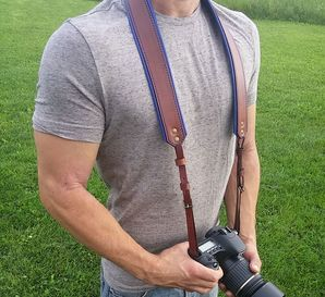 Sexy guy using camera strap